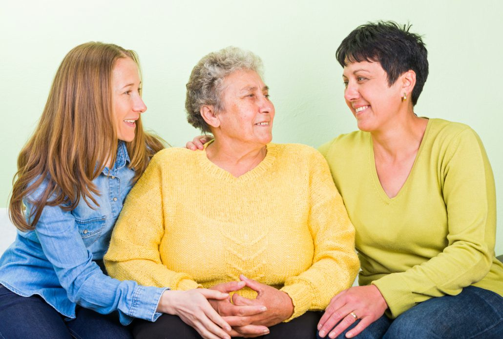 Photo of elderly woman with her daughters