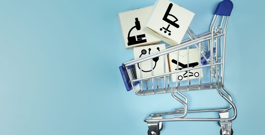 Mini shopping cart with cardboard boxes. Concept internet online shopping and delivery of goods. Copy space
